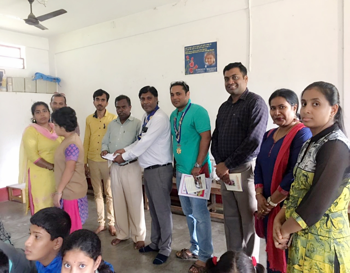 Donation of school fee and uniform to special kid