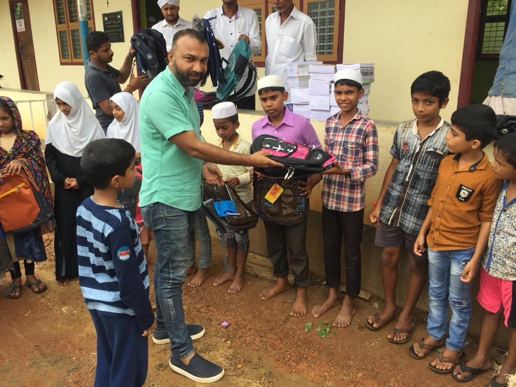 Flood Relief School Bags and Books distribution