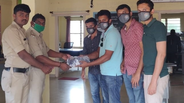 Distribution of protective face masks with RTI Logo